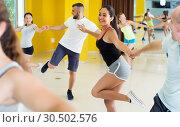 Купить «Girl is dancing rock-n-roll with partner», фото № 30502576, снято 21 июня 2017 г. (c) Яков Филимонов / Фотобанк Лори