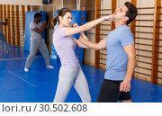 Купить «People practicing self defense techniques», фото № 30502608, снято 31 октября 2018 г. (c) Яков Филимонов / Фотобанк Лори