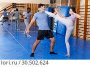 Купить «People practicing self defense techniques», фото № 30502624, снято 31 октября 2018 г. (c) Яков Филимонов / Фотобанк Лори