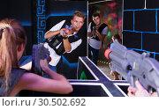 Купить «Excited people playing enthusiastically laser tag game», фото № 30502692, снято 27 августа 2018 г. (c) Яков Филимонов / Фотобанк Лори