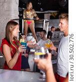 Купить «Female and male clubbing with cocktail in the club on party», фото № 30502776, снято 28 августа 2017 г. (c) Яков Филимонов / Фотобанк Лори