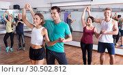 Купить «Men and women dancing salsa o bachata», фото № 30502812, снято 27 мая 2019 г. (c) Яков Филимонов / Фотобанк Лори