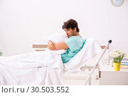 Купить «Young handsome man staying in hospital», фото № 30503552, снято 6 сентября 2018 г. (c) Elnur / Фотобанк Лори