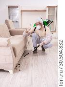 Купить «Pest control contractor working in the flat», фото № 30504832, снято 12 ноября 2018 г. (c) Elnur / Фотобанк Лори