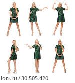 Купить «Young woman in green dress isolated on white», фото № 30505420, снято 22 сентября 2014 г. (c) Elnur / Фотобанк Лори