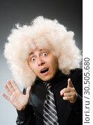 Купить «Young man wearing afro wig», фото № 30505680, снято 15 июня 2014 г. (c) Elnur / Фотобанк Лори