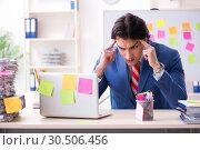 Купить «Young male handsome employee in conflicting priorities concept», фото № 30506456, снято 7 января 2019 г. (c) Elnur / Фотобанк Лори