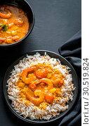 Купить «Thai yellow curry with seafood and white rice», фото № 30519824, снято 9 апреля 2016 г. (c) easy Fotostock / Фотобанк Лори
