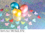 Купить «Easter background. Colored pearl eggs of gold, pink, coral, blue and turquoise on a halo background with a copy space», фото № 30522372, снято 31 марта 2019 г. (c) Светлана Евграфова / Фотобанк Лори