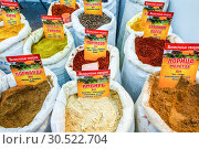 Купить «Russia, Samara, March 2017: Packages with spicy spices from Abkhazia at the fair. Text in Russian: Oriental spices. Coriander Ginger Cinnamon Tomato», фото № 30522704, снято 19 марта 2017 г. (c) Акиньшин Владимир / Фотобанк Лори
