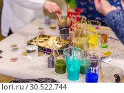 Купить «Russia, Samara, February 2019: Master-class on painting small wooden items.», фото № 30522744, снято 23 февраля 2019 г. (c) Акиньшин Владимир / Фотобанк Лори