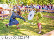 Russia, Samara, September 2018: Spectacular staged battles of Slavic warriors and knights at the festival in Zagorodny Park. Редакционное фото, фотограф Акиньшин Владимир / Фотобанк Лори