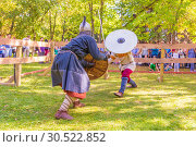 Купить «Russia, Samara, September 2018: Spectacular staged battles of Slavic warriors and knights at the festival in Zagorodny Park.», фото № 30522852, снято 16 сентября 2018 г. (c) Акиньшин Владимир / Фотобанк Лори