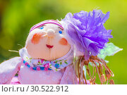 Купить «Russia, Samara, September 2018: Portrait of a woman rag doll on a green background.», фото № 30522912, снято 16 сентября 2018 г. (c) Акиньшин Владимир / Фотобанк Лори