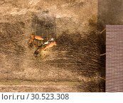 Купить «Aerial view from drone horse farm with animals eating hay from a wooden box on a sunny day.», фото № 30523308, снято 28 июля 2018 г. (c) Ярослав Данильченко / Фотобанк Лори