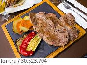 Купить «Beef steak with baked potatoes, romesco, vegetables», фото № 30523704, снято 19 апреля 2019 г. (c) Яков Филимонов / Фотобанк Лори