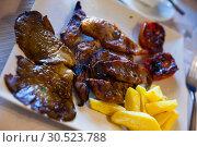 Купить «Plate of tasty roasted mutton», фото № 30523788, снято 4 июля 2020 г. (c) Яков Филимонов / Фотобанк Лори
