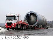 Купить «Forssa, Finland - March 16, 2019: Sisu Polar Hauler 625 of Vuorsola Oy in front of oversize load silo. Lenght of transport 45 meters, weight 156 Tonne.», фото № 30524660, снято 16 марта 2019 г. (c) age Fotostock / Фотобанк Лори