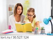 Купить «mother and daughter doing homework together», фото № 30527124, снято 7 октября 2018 г. (c) Syda Productions / Фотобанк Лори