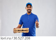 Купить «indian delivery man with pizza showing thumbs up», фото № 30527208, снято 12 января 2019 г. (c) Syda Productions / Фотобанк Лори