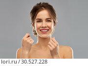 Купить «happy young woman with dental floss cleaning teeth», фото № 30527228, снято 20 января 2019 г. (c) Syda Productions / Фотобанк Лори