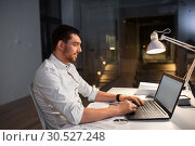 Купить «businessman with laptop working at night office», фото № 30527248, снято 25 января 2019 г. (c) Syda Productions / Фотобанк Лори