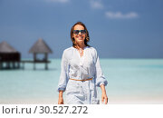 Купить «happy woman over tropical beach and bungalow», фото № 30527272, снято 15 июня 2018 г. (c) Syda Productions / Фотобанк Лори