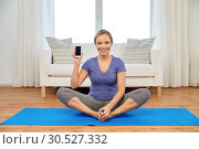 Купить «woman with smartphone doing yoga at home», фото № 30527332, снято 13 ноября 2015 г. (c) Syda Productions / Фотобанк Лори