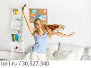 Купить «happy woman in headphones having fun at home», фото № 30527340, снято 14 ноября 2015 г. (c) Syda Productions / Фотобанк Лори