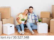 Купить «happy couple with boxes moving to new home», фото № 30527348, снято 25 февраля 2016 г. (c) Syda Productions / Фотобанк Лори