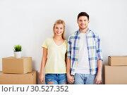 Купить «happy couple with boxes moving to new home», фото № 30527352, снято 25 февраля 2016 г. (c) Syda Productions / Фотобанк Лори