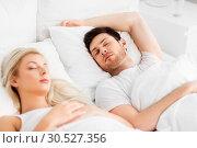 Купить «happy couple sleeping in bed at home», фото № 30527356, снято 25 февраля 2016 г. (c) Syda Productions / Фотобанк Лори