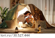 Купить «happy family with smartphone in kids tent at home», фото № 30527444, снято 27 января 2018 г. (c) Syda Productions / Фотобанк Лори
