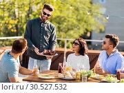 Купить «friends at bbq party on rooftop in summer», фото № 30527532, снято 2 сентября 2018 г. (c) Syda Productions / Фотобанк Лори