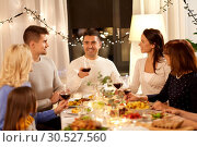 Купить «happy family having dinner party at home», фото № 30527560, снято 15 декабря 2018 г. (c) Syda Productions / Фотобанк Лори