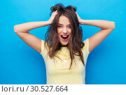 Купить «smiling young woman holding to her head or hair», фото № 30527664, снято 29 января 2019 г. (c) Syda Productions / Фотобанк Лори