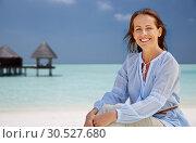 Купить «happy woman over tropical beach and bungalow», фото № 30527680, снято 15 июня 2018 г. (c) Syda Productions / Фотобанк Лори