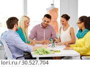 Купить «team of fashion designers working at office», фото № 30527704, снято 17 мая 2014 г. (c) Syda Productions / Фотобанк Лори