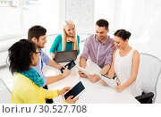 Купить «creative team with table computers in office», фото № 30527708, снято 17 мая 2014 г. (c) Syda Productions / Фотобанк Лори
