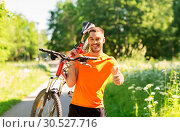 happy man with bicycle showing thumbs up in summer. Стоковое фото, фотограф Syda Productions / Фотобанк Лори