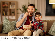 Купить «happy father and son watching tv at home», фото № 30527808, снято 4 ноября 2018 г. (c) Syda Productions / Фотобанк Лори