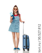 Купить «teenage girl with travel bag and air ticket», фото № 30527812, снято 30 июня 2018 г. (c) Syda Productions / Фотобанк Лори