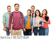 Купить «group of smiling students with books», фото № 30527824, снято 10 ноября 2018 г. (c) Syda Productions / Фотобанк Лори