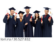 Купить «graduates in mortar boards with diplomas», фото № 30527832, снято 10 ноября 2018 г. (c) Syda Productions / Фотобанк Лори