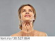 Купить «smiling young woman touching her neck», фото № 30527864, снято 20 января 2019 г. (c) Syda Productions / Фотобанк Лори