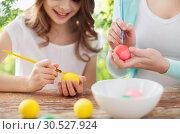 Купить «happy smiling girl and mother coloring easter eggs», фото № 30527924, снято 1 марта 2014 г. (c) Syda Productions / Фотобанк Лори