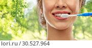 Купить «close up of woman with toothbrush cleaning teeth», фото № 30527964, снято 20 января 2019 г. (c) Syda Productions / Фотобанк Лори