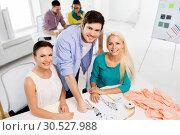 Купить «team of fashion designers working at office», фото № 30527988, снято 17 мая 2014 г. (c) Syda Productions / Фотобанк Лори