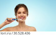 Купить «smiling woman with toothbrush cleaning teeth», фото № 30528436, снято 20 января 2019 г. (c) Syda Productions / Фотобанк Лори