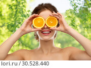 Купить «smiling woman with oranges over grey background», фото № 30528440, снято 20 января 2019 г. (c) Syda Productions / Фотобанк Лори